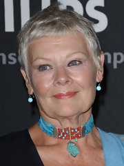 Judi Dench finished off her look with a cool pixie cut.