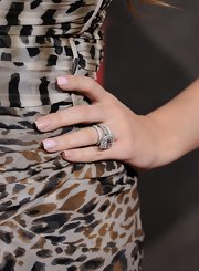 Khloe Kardashian gave her leopard print dress a soft touch with neutral nail polish.