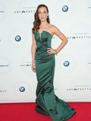 Maggie Q was svelte and elegant in a structured strapless emerald gown by Zac Posen at the Unforgettable Gala.