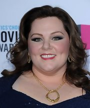 Melissa McCarthy wore sultry smoky blue shades of shadow to complement her dress at the 17th Annual Critics' Choice Movie Awards.