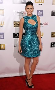 For one of her finest fashion moments, Nina looked electric in this teal beaded cocktail dress at the Critics' Choice Movie Awards.