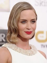 Matte red lips put the finishing touch on Emily's Old Hollywood look.