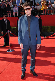 Zac stood out on the red carpet in a blue suit.