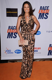 Tia Carrere's nude leather clutch was a low-key contrast to her hot dress at the Race to Erase MS event.