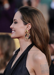 Angelina Jolie attended the 18th Annual SAG Awards wearing her long hair sleek and straight.