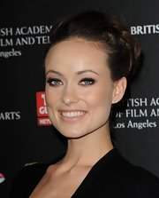 Olivia Wilde opted for a sophisticated hairdo with a bit of volume at the root. Pinning her long locks in a loose bun was the perfect way to showcase her beauty.