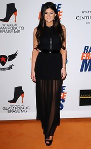 Kylie Jenner arrived at the 19th Annual Race to Erase MS Gala wearing a chic black halter maxi dress.
