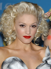 Gwen Stefani wore a glittering hair pin in her bright blond curls.