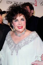 Liza Minnelli wore a diamond studded flower choker at Elton John's Oscar party.