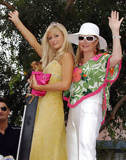 Kathy Hilton looked summer-chic at the LA Gay Pride Parade in her floral outfit, straw hat, and white-rimmed Chanel sunnies.