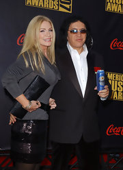 Shannon Tweed matched her simple sweater with a sequined short skirt for the American Music Awards.