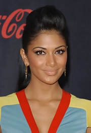 Nicole Scherzinger showed off her nude lipstick while attending the American Music Awards. It was a subtle touch to her bold lashes.