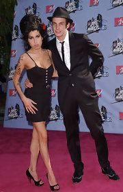 Amy Winehouse paired her black frock with satin peep-toe pumps that showed off her red manicure.