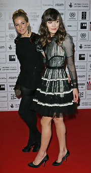 Her victorian style shows in this white and black lace dress. Keira keeps it simple and elegant with this satin pump.