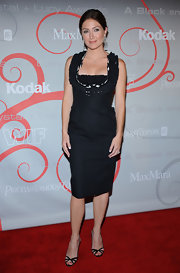 Sasha Alexander focused attention on her ruffled black dress with a pair of matching dainty sandals.