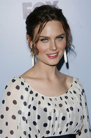 Emily paired her polka dot dress with large white dangle earrings.