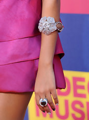 Solange added a sparkling touch to her fuchsia pink dress with a flower bangle bracelet.