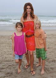 Kaya Gerber was oh-so-pretty at the beach in her sleeveless pink bubble-hem blouse.