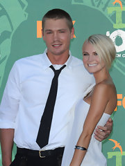 Chad wears a narrow solid tie with an interesting button detail while out with Kenzie Dalton, his fiance.