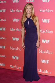 Holly dons a simple silhouette in this purple floor length evening gown.