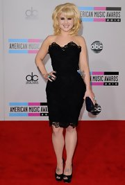 Kelly Osbourne got a boost from timeless black peep toe pumps. The platform heels are subtly glittery for a stunning look.