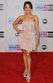 Cheryl Burke donned chunky nude wedges with her blush strapless dress. The heels feature a circular center design.