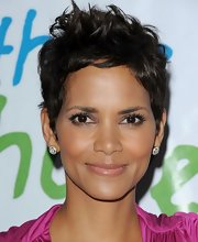 Halle Berry completed her glowing look with a nude lip gloss.