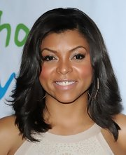Taraji P. Henson styled framed her face with long layered tresses at the Silver Rose Gala in Beverly Hills.