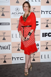 Vera wears a red peasant dress with a leather belt for the Spirit Awards.