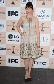 Amber Tamblyn kept her retro chiffon shirtdress grounded with gray wool pumps.
