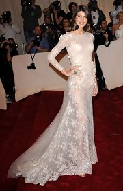 Michelle was a vision at the Met Ball in a sheer white lace evening gown and an emerald ring.