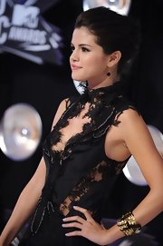 Selena Gomez sported a cool gold cuff bracelet with black embellishment at the 2011 MTV Video Music Awards.