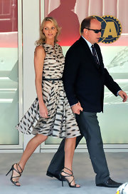 Charlene looked sweet at the Monaco Grand Prix in a printed day dress and strappy stilettos.