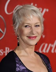 Helen Mirren spiced up her look with black onyx and diamond earrings.