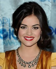 Lucy Hale accented her plunging neckline with a 14-karat gold diamond necklace.