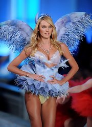 Candice Swanepoel wore a Moonlight necklace in 18-carat noble gold with rock crystal and diamonds during the 2011 Victoria's Secret Fashion Show.