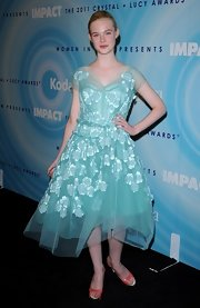 Elle was perfectly youthful in a blue chiffon appliqued frock for the Lucy Awards.