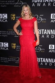 Natasha Henstridge showed off her voluptuous figure in a red lace evening dress at the BAFTA Britannia Awards.