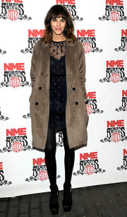 Alexa Chung paired her winter style with black platform peep-toe pumps.