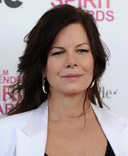 Marcia Gay Harden wore a pair of steel tooth dangle earrings at the 2013 Independent Spirit Awards.
