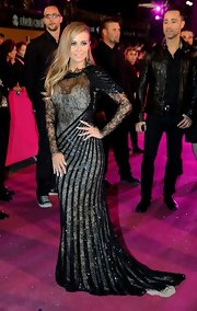 Carmen Electra stepped out in this gray and black lace and swirl gown.