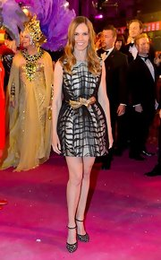 Hilary Swank looked flirty and chic in a gray tiger stripe dress with black mesh overlay and a gold bow belt.