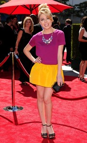 Jennette McCurdy brought a fun vibe to the Emmys red carpet with this purple knit top and yellow mini skirt combo.