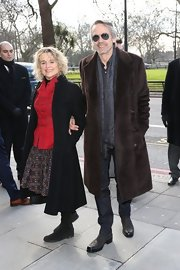Jeremy Irons showed his eclectic style with a knee-length fur coat.