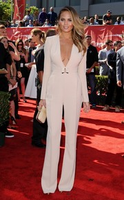 Sticking to a neutral palette, Chrissy Teigen accessorized with a beige python hard-case clutch.