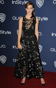 Emma Watson exuded ultra-feminine appeal in a sheer, beaded black dress by Theory by Olivier Theyskens during the Golden Globes after-party.