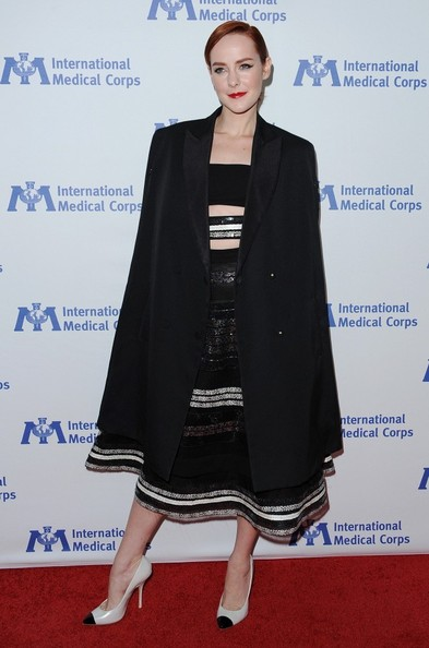 Jena Malone arrived for the International Medical Corps Awards wearing a black cape over a striped dress.