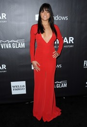 Michelle Rodriguez flaunted some cleavage in a deep-V red evening dress by The 2nd Skin Co. during the amfAR Inspiration LA Gala.