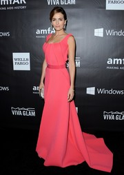 Camilla Belle looked absolutely radiant in a bright pink Carolina Herrera gown during the amfAR Inspiration LA Gala.