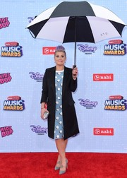 Kelly Osbourne opted for a black tuxedo coat and polka-dot dress combo when she attended the Radio Disney Music Awards.